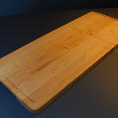 Cutting board with a grease groove